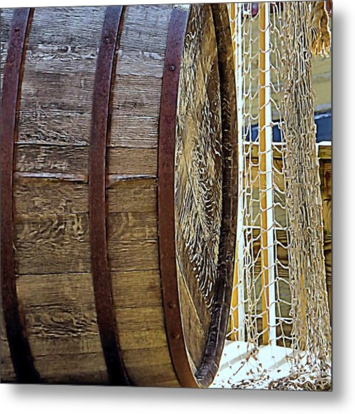 Wooden Barrel And Net Metal Print by Janice Drew