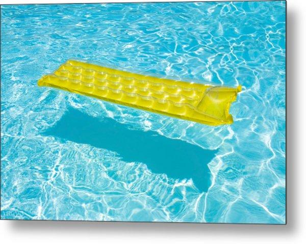 Yellow Raft Floating In A Pool Metal Print