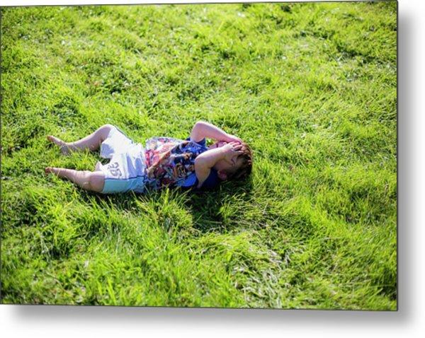 Young Boy Lying On Grass Metal Print by Samuel Ashfield