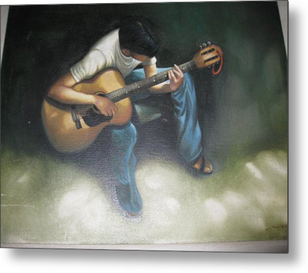 Young Boy Playing The Guitar Metal Print
