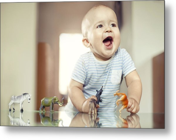 Young Boy Playing With Toy Animals Metal Print by Orbon Alija
