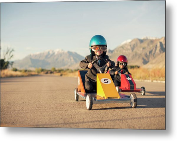Young Boy Races Toy Car Wearing Metal Print by Richvintage