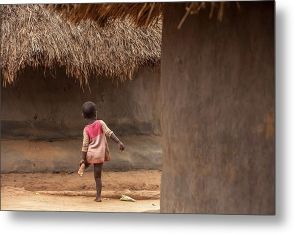Young Child In A Village Metal Print