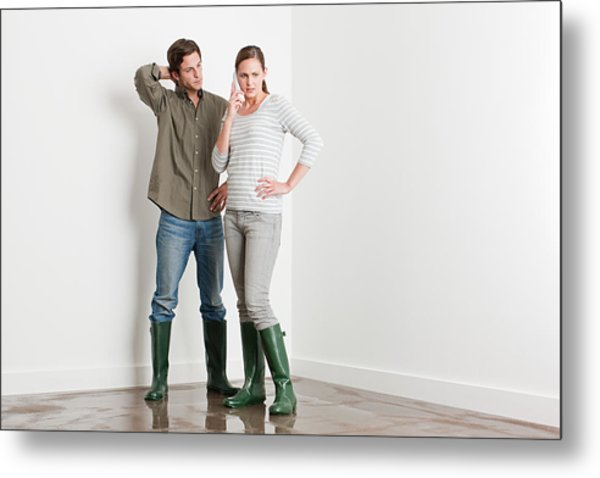 Young Couple On Flooded Floor Metal Print by Image Source