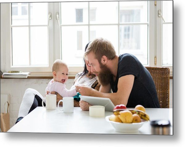 Young Family With Baby Having Fun Metal Print by Hinterhaus Productions