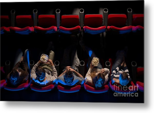 Young People Sitting At The Cinema Metal Print by Stock-asso