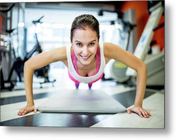 Young Woman Doing Press-ups Metal Print by Science Photo Library
