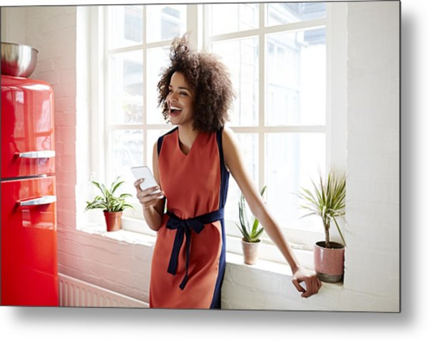 Young Woman Laughing In A Trendy Apartment Metal Print by Ezra Bailey