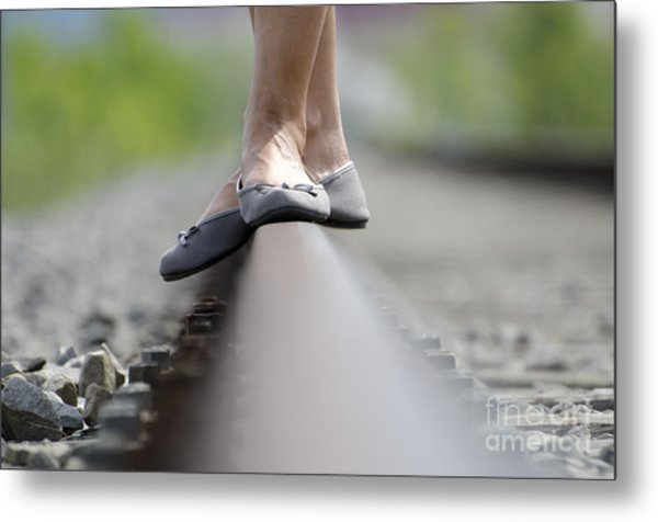 Balance On Railroad Tracks Metal Print