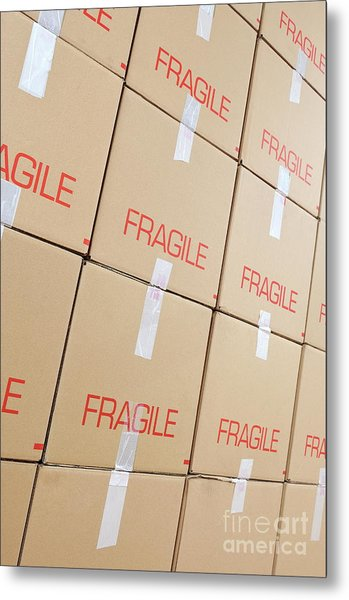 Stacks Of Cardboard Boxes Marked 'fragile' Metal Print by Sami Sarkis