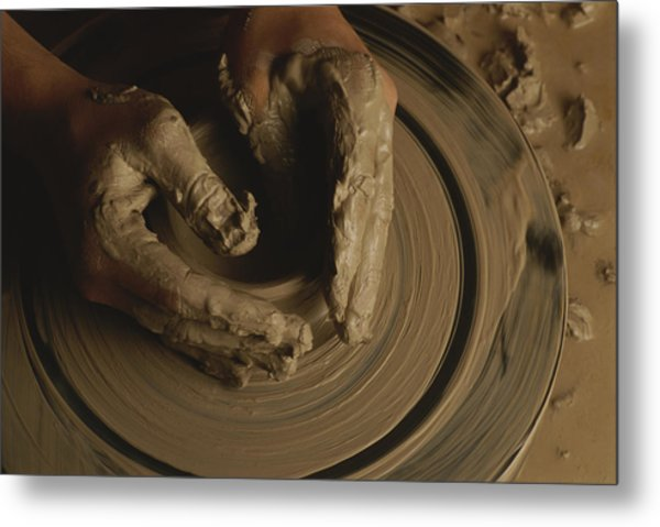 A Potter Makes A Pot From Clay Metal Print