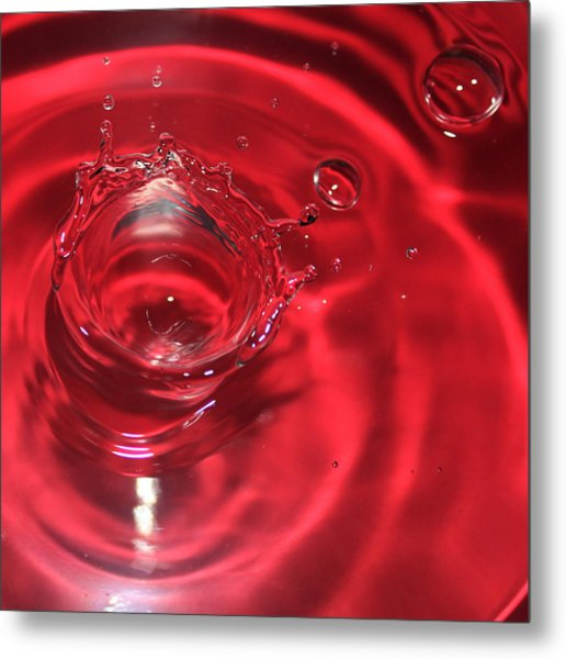 A Red Splash Of Water Metal Print