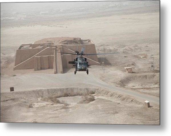 A Us Army Black Hawk Helicopter Hovers Metal Print by Everett