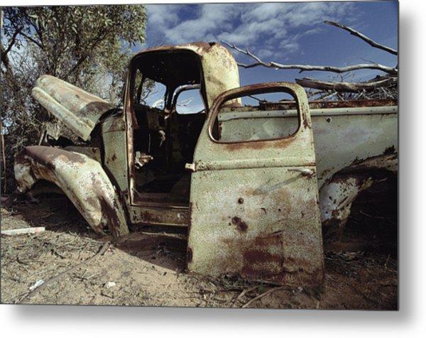 An Old Wrecked Truck In A Desert Metal Print