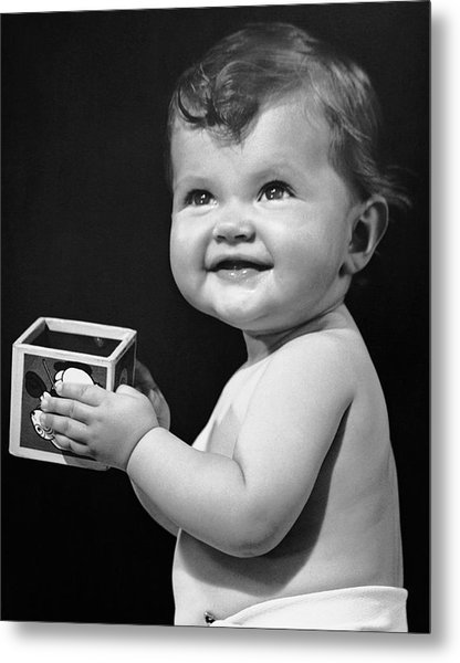Baby Holding Block Metal Print by George Marks