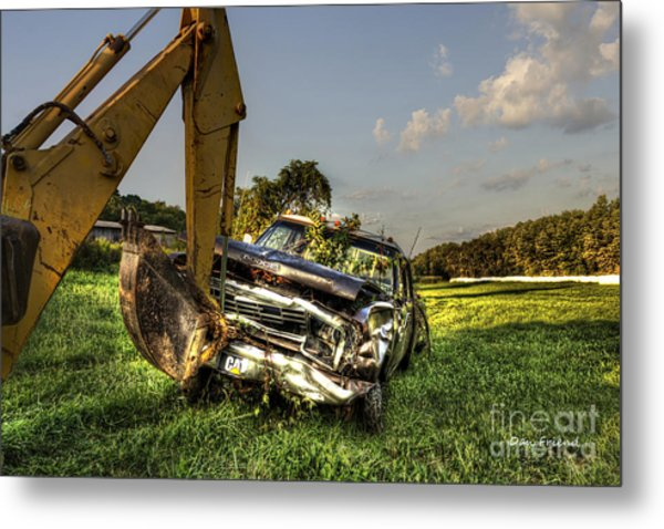 Backhoe Pulling Car Out Of Field Metal Print by Dan Friend