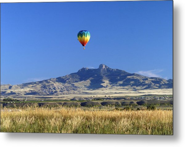 Balloon Over Heart Mountain Metal Print by Lora Ballweber