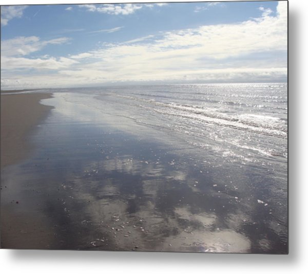 Beach Clouds Metal Print by Emma Manners