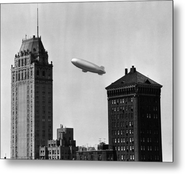 Blimp Over City Metal Print by George Marks