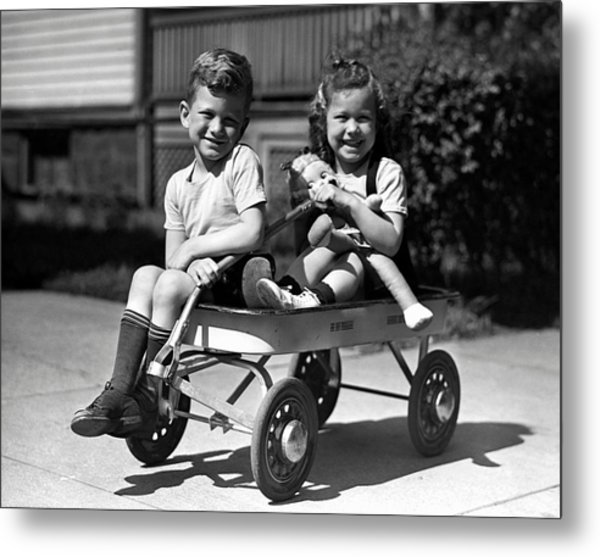 Boy & Girl On Wagon Metal Print by George Marks