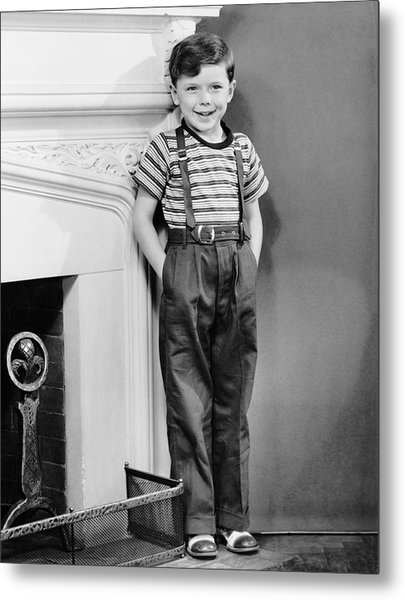 Boy Leaning Against Wall By Fireplace Metal Print by George Marks