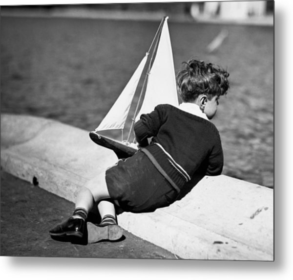 Boy Playing With Toy Sailboat Metal Print by George Marks