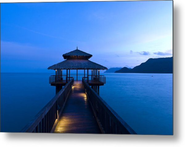 Building At The End Of A Jetty During Twilight Metal Print