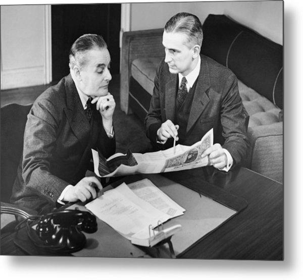Businessmen Having A Meeting Metal Print by George Marks