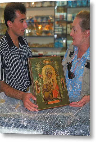 Buying Icon In Jerusalem Metal Print by Carl Purcell