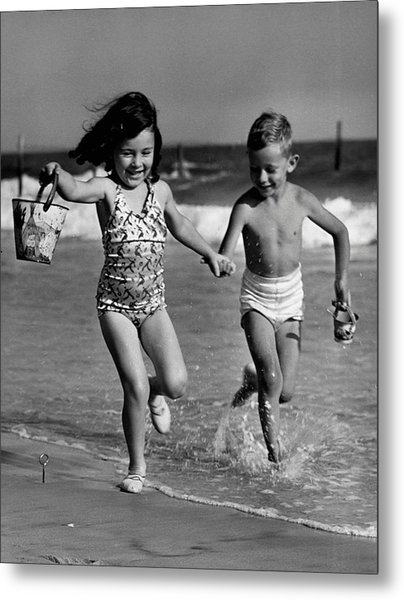 Children Playing At Seashore Metal Print by George Marks