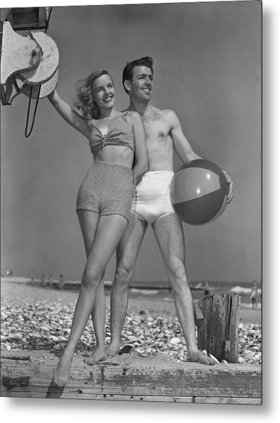 Couple On Beach W/beach Ball Metal Print by George Marks