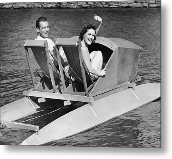 Couple On Lake In Paddle Boat Metal Print by George Marks