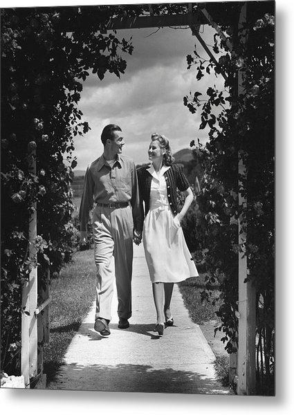 Couple Outdoors Holding Hands While Walking Metal Print by George Marks