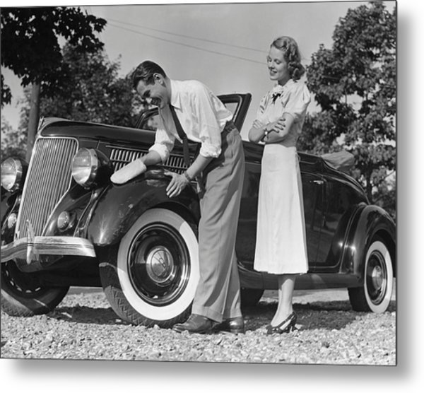 Couple Polishing Car Metal Print by George Marks
