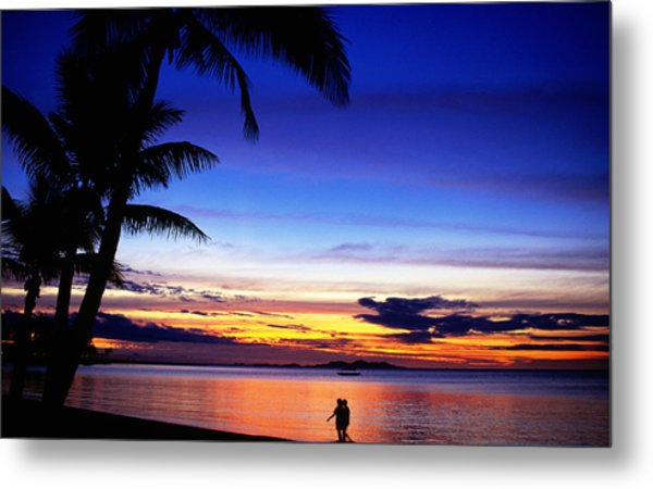 Couple Walking Along Beach At Sunset, Fiji Metal Print by Peter Hendrie