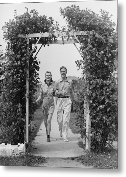 Couple Walking On Footpath Towards Rose Covered Pergola, (b&w) Metal Print by George Marks