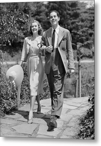 Couple Walking Together Outdoors Metal Print by George Marks