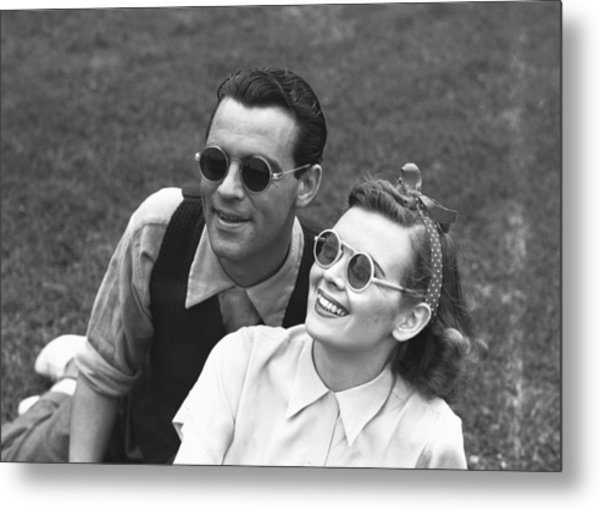 Couple Wearing Sunglasses Sitting On Grass, (b&w) Metal Print by George Marks