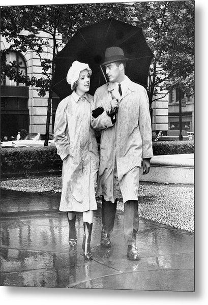 Couple W/umbrella Walking In The Rain Metal Print by George Marks