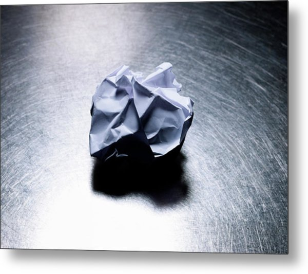 Crumpled Sheet Of White Paper On Stainless Steel. Metal Print by Ballyscanlon