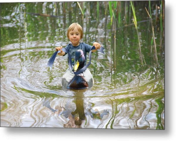 Cute Tiny Boy Riding A Duck Metal Print by Jaroslaw Grudzinski