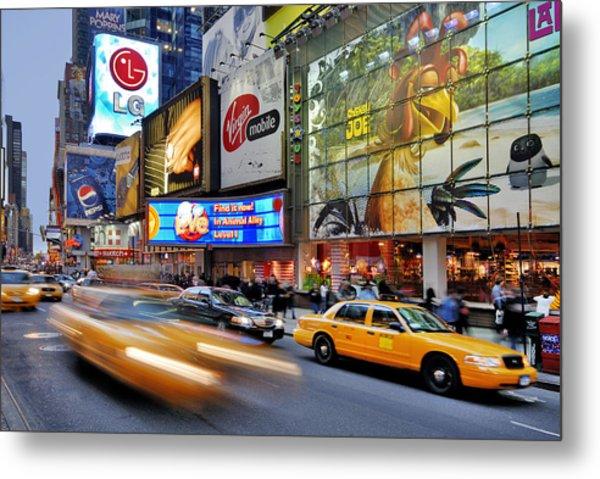 Evening Traffic At Times Square Metal Print by Izzet Keribar