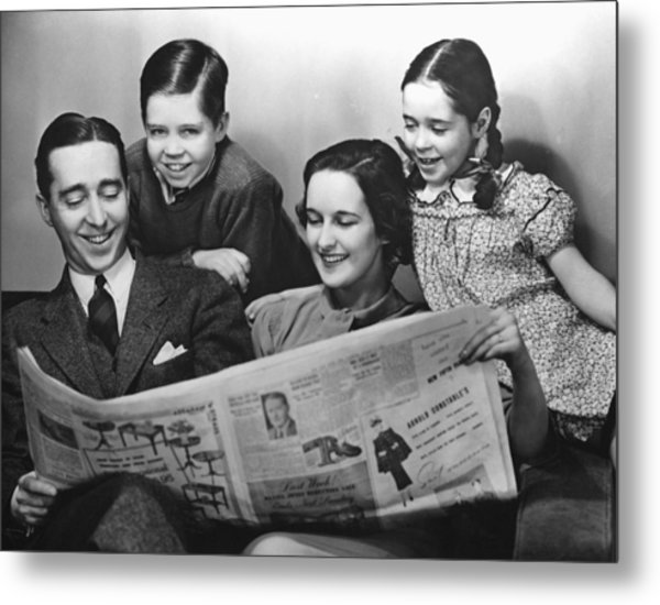 Family Reading Newspaper Metal Print by George Marks