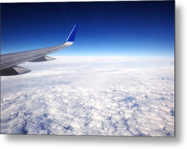 Flying Above The Clouds Metal Print