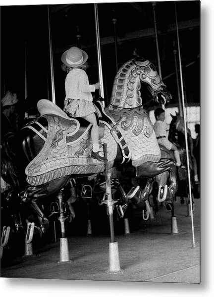 Girl Riding A Carousel Metal Print by George Marks