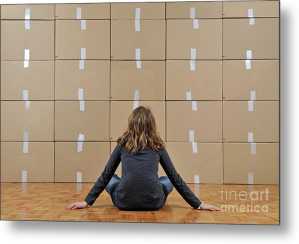 Girl Seated In Front Of Cardboard Boxes Metal Print by Sami Sarkis