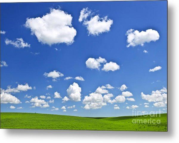 Green Rolling Hills Under Blue Sky Metal Print