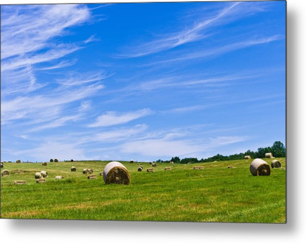 Hay Bales Under Brilliant Blue Sky Metal Print