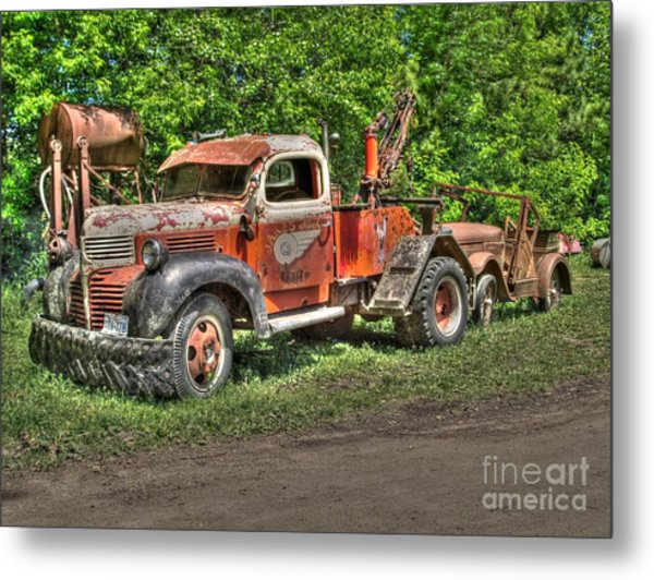 In Tow Metal Print by Jimmy Ostgard