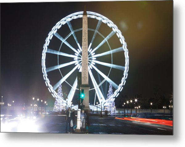 la concorde ferris wheel at paris champs elysees at night during christmas metal print by mao